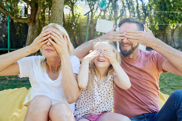 Portrait of happy family covering their eyes - SRYF00666