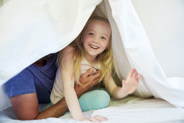 Happy girl  with father in bed under blanket - SRYF00687