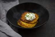 Potato fritters with herbed curd cheese in bowl - LVF06562