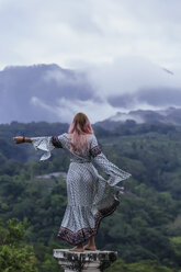 Indonesia, Bali, young woman standing on base - KNTF00934