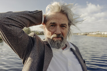 Portrait of serious senior man at a lake - KNSF03334