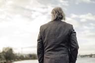 Rear view of senior man at a lake - KNSF03370