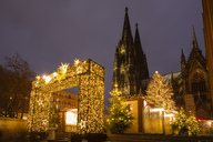 Germany, Cologne, Christmas market with Cologne Cathedral in the background - WIF03476