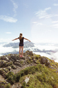Austria, South Tyrol, female hiker, teenage girl arms outstretched - FKF02862