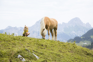Austria, South Tyrol, young girl with horse on meadow - FKF02868