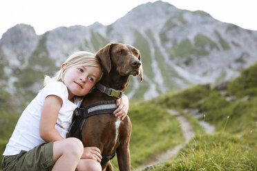 Austria, South Tyrol, young girl with her dog - FKF02871