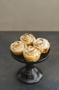 Home-baked small apple tart with rose pattern on cake stand - ECF01950