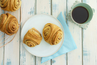 Home-baked Franzbroetchen and cup of coffee - ECF01959