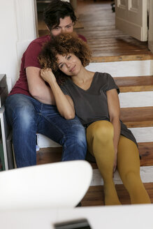 Young couple at home relaxing on stairs - HHLMF00073