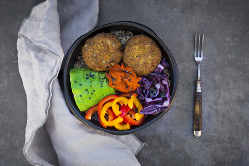 Lunch bowl of quinoa, red cabbage, bell pepper, avocado, quinoa fritters, ajvar and black sesame - LVF06571