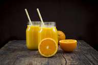 Freshly squeezed orange juice in jars with straws - LVF06577