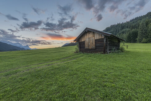 Germany, Bavaria, Werdenfelser Land, hay barn at sunrise - RPSF00078