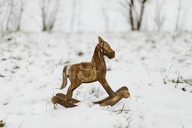 Wooden rocking horse in snow - KMKF00108