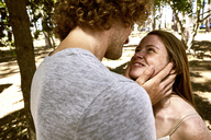 Happy young couple in love in forest - SRYF00723