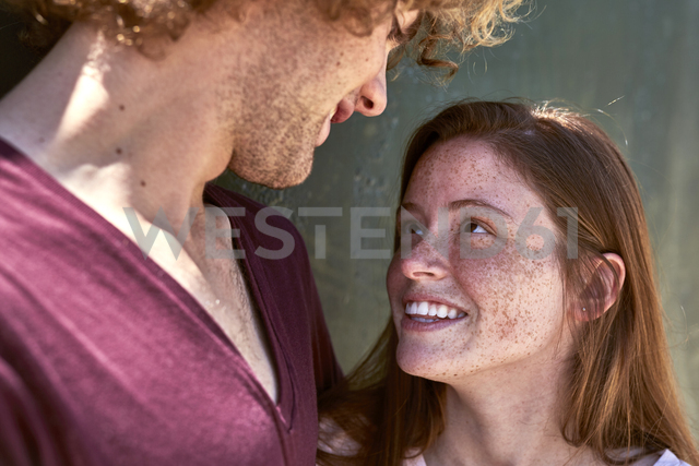 Smiling young woman in love looking at boyfriend - SRYF00753