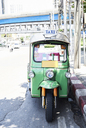 Thailand, Bangkok, green tuk-Tuk vehicle parked on the stree - IGGF00342