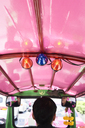 Thailand, Bangkok, back view of driver in his tuk-tuk taxi - IGGF00345