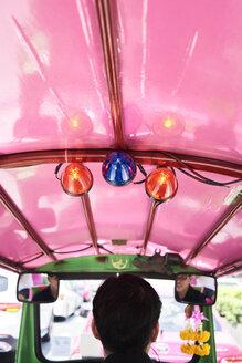 Thailand, Bangkok, back view of driver in his tuk-tuk taxi - IGGF00345