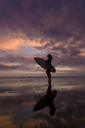 Indonesia, Bali, young woman with surfboard - KNTF00957