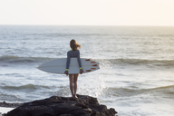 Indonesia, Bali, young woman with surfboard - KNTF00963