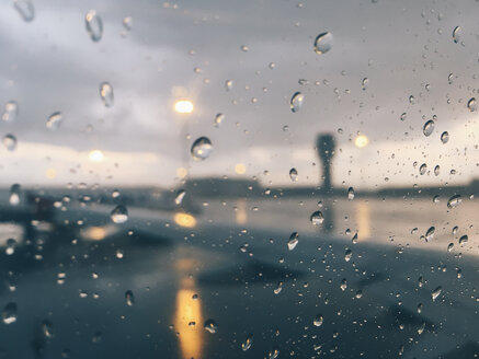 Raindrops through airplane window. Sofia, Bulgaria. - BZF00376