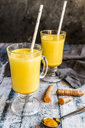 Two glasses of curcuma milk - SARF03459