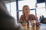 Portrait of laughing young woman in a cafe - ZEDF01058
