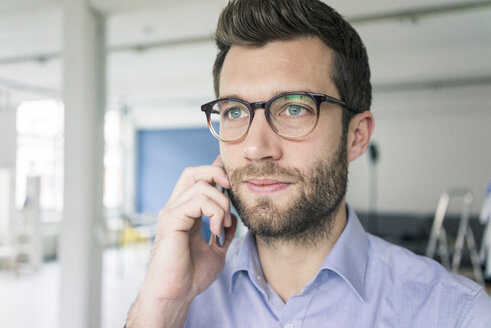 Portrait of businessman on cell phone - MOEF00644