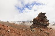 Reunion, Reunion National Park, Piton de la Fournaise, Route du volcan, Tourist in the Plaine des Sables - FOF09623