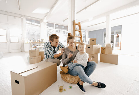 Happy family moving into new home - KNSF03388