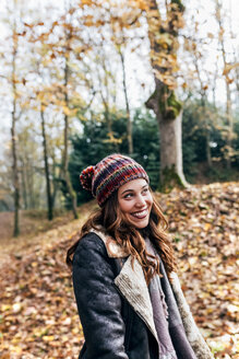 Portrait of a beautiful happy woman in an autumnal forest - MGOF03698