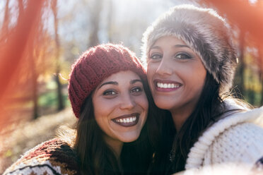 Selfie of two happy pretty women in an autumnal forest - MGOF03716