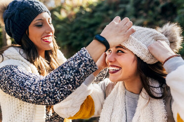 Two pretty women having fun with wooly hats - MGOF03731