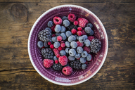 Bowl of deep frozen red currents, rapsberries and blackberries - LVF06594