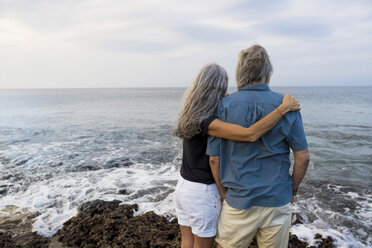 Senior couple looking at the ocean, rear view - SBOF01050