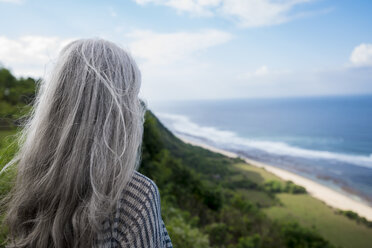 Senior woman overlooking ocean - SBOF01056