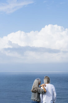 Senior couple looking at the ocean, rear view - SBOF01059