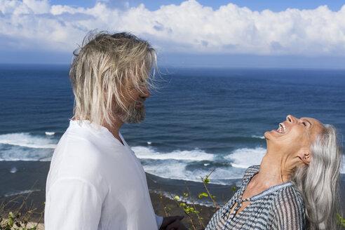 Laughing senior couple having fun at the sea - SBOF01062