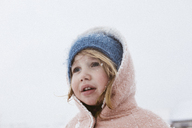 Portrait of little girl in snowfall - KMKF00130