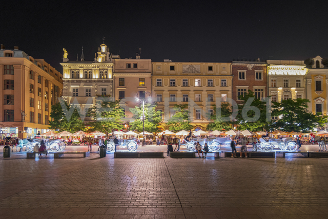 Poland, Krakow, Old town, town houese at main square by night - CSTF01586