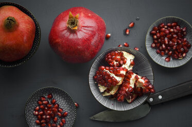 Pomegranate and pomegranate seeds in bowl - ASF06145