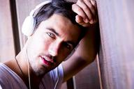 Portrait of handsome young man wearing headphones - SIPF01919