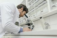 Man using microscope in laboratory - MFF04309