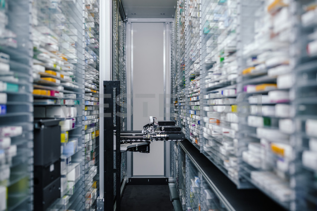 Medicine in shelves in commissioning machine in pharmacy - MFF04363
