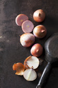 Sliced and whole pink onions on rusty ground - CSF28668