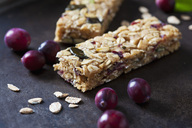 Muesli bars with cranberries and oat flakes on dark background - CSF28704