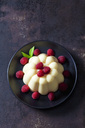 Custard with raspberries on plate - CSF28728