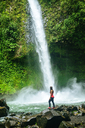 Costa Rica, Arenal Volcano National Park, Woman at the waterfall of La Fortuna - KIJF01857
