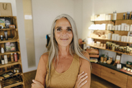 Portrait of smiling businesswoman in her shop - KNSF03516
