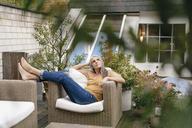 Woman relaxing on terrace - KNSF03528